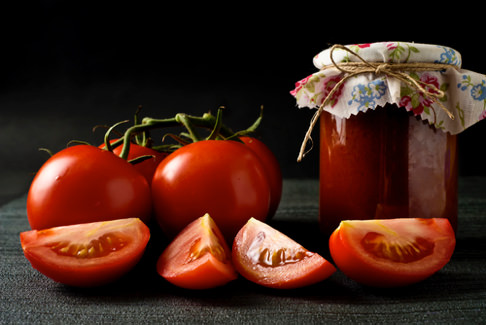 Tomato and a salsa jar