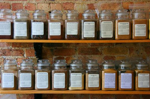 Spice Jars on Wooden Shelf